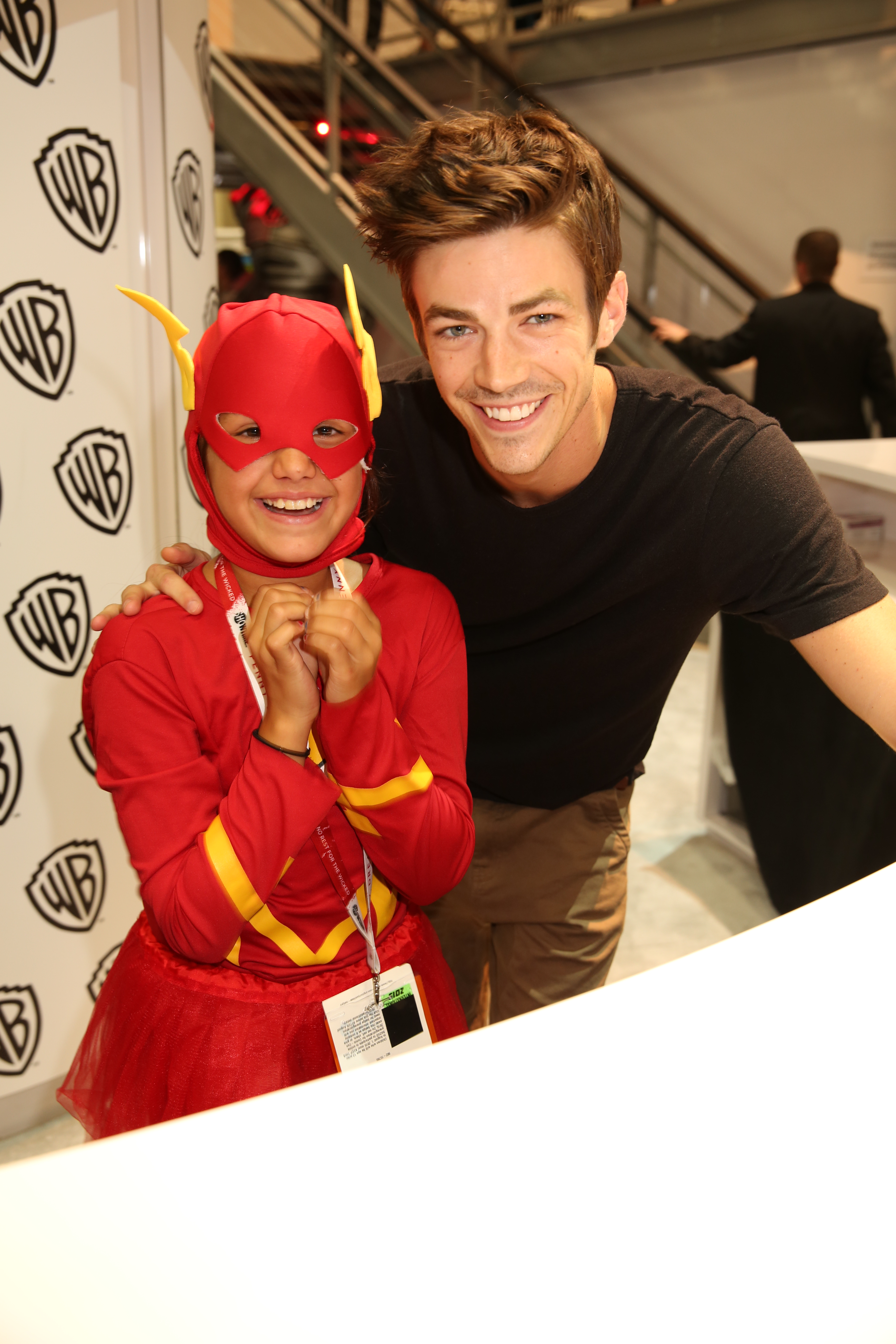 The flash signing a young flash meets his tv counterpart series star grant gustin at the flash signing in the warner bros booth during comic con 2015 wbsdcc 2015 wbei m4hsunfo Image collections