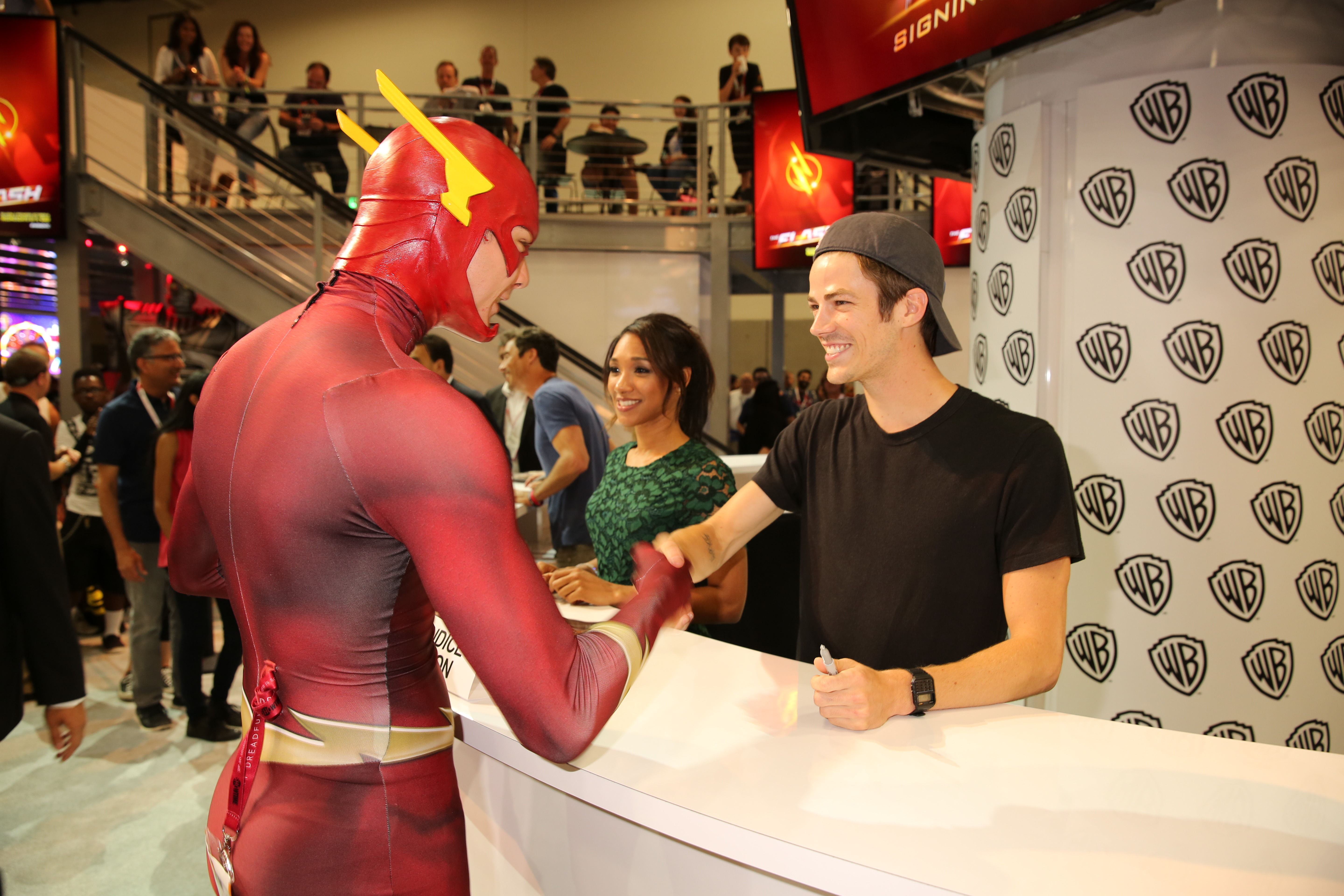 The flash signing a super flash fan meets series star grant gustin barry allenthe flash at the flash signing in the warner bros booth during comic con 2015 m4hsunfo Image collections